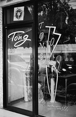 Tong - Bangkok (35mm) (jcbkk1956) Tags: window glass sign analog reflections thailand mono blackwhite bangkok rangefinder salon konica manual tong hairdressers thonglo ilfordpan100 konicaautos2