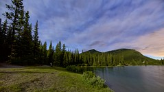 Bench at Forget-Me-Not pond (John Andersen (JPAndersen images)) Tags: blue sky panorama moon lake mountains night clouds reflections bench stars kananaskis colours alberta stump elbowfalls elbowriver forgetmenotpond