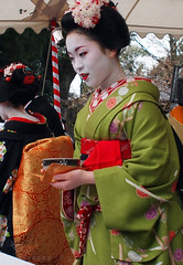 Maiko 'Ichimari' / Tea Ceremony (Marie Eve K.A. (Away)) Tags: travel winter people flower colour tree nature japan lady spring women kyoto maiko geiko geisha  kimono teaceremony annual february teaparty 2012  nodate plumblossoms baikasai feb25 kitanotenmangushrine    geigi  february25th   kamihichiken outdoorteaparty plumflowerfestival ichimari  feb252012 plumblossomsfestival plumflowersfestival