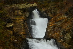 Water in a Barren Land (SunnyDazzled) Tags: trees winter nature water creek landscape waterfall sticks rocks natural pennsylvania dry falls cliffs poconos grasses cascade tiers delawarewatergap cascada dwg raymondskill