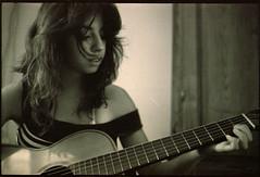 Tentativo in Re maggiore (Fabio Leone) Tags: portrait woman mamiya girl hands kodak guitar sicily 500 dtl