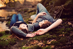 Love On The Rocks (Cameron Bushong) Tags: trees boy green wet water girl 50mm moss woods rocks stream affection bokeh fingers smiles twigs 366