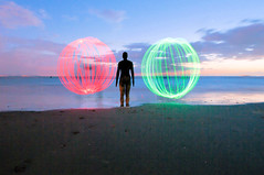 Balls (Chris Willis 10) Tags: longexposure light sea art beach statue night globe sand long exposure neon glow spin footprints orb balls sphere crosby antonygormley anotherplace ilobsterit