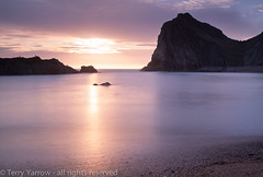 The Pastel Shades of Evening (Terry Yarrow) Tags: uk light sunset sea england canon landscape evening coast movement dorset contrejour possibles durdledoor eos5d dorsetcoastpath manowarbay