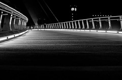 a night's stroll (-issata) Tags: bridge blackandwhite architecture lights movement downtown sandiego bokeh strangers pedestrian clocktower depthoffield nighttime photowalk railing stroll nikond7000 nikkor35mmf18gafs