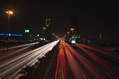 Metropolitan nights (Wajahat Mahmood) Tags: street longexposure red urban white color colour cars car skyline architecture night skyscraper colorful cityscape traffic middleeast clear trail busy arab colourful riyadh saudiarabia hdr highdynamicrange ksa kingdomtower   kingdomcentre olaya   kingfahdroad kingfahadroad kingdomcenter