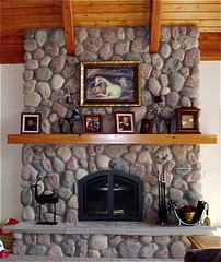 Fieldstone Fireplace (North Twin Builders) Tags: pictures wood summer vacation horse brown house lake clock home stone wisconsin architecture kids carpet grey design construction cabin fireplace warm candles doors candle arch photos timber interior rustic beam livingroom poker eagleriver hearth upnorth custom centerpiece stgermain contractor wi beams mantle phelps builder northwoods conover decorated landolakes threelakes fieldstone customhome vilascounty northernwi lakehome custombuilder northtwinbuilders