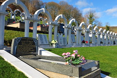 White Arches of Aberfan (Child Memorials) (Simon Downham) Tags: life flowers england mountain news black mountains green history monument loss cemetery grave childhood statue wales angel children death sadness memorial mine village child play god hill prayer pray praying memories innocent pit mining hills angels tragedy valley disaster memory innocence why coal mound tragic weeping prayers grief weep prays coalmine goverment inquiry catastrophic catastrophe grieving enquiry innocents investigation merthyr ncb slurry bereft accountability slagheap coalpit culpable smother aberfan bereavement culpability nationalcoalboard dsc0487 inquirey enquirey