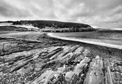 Middle Cove Beach (Karen_Chappell) Tags: ocean blackandwhite bw seascape beach newfoundland landscape scenery rocks hill scenic rocky wideangle atlantic nfld canda middlecove