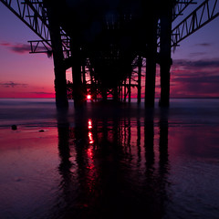 Under the boardwalk, down by the sea (s0ulsurfing) Tags: ocean uk blue sea england english praia beach nature water silhouette composition canon island photography bay coast pier mar scenery natural britain wide shoreline blues wideangle coastal photograph shore vectis isleofwight april vista coastline british isle channel englishchannel wight 2012 lamanche 10mm totland sigma1020 totlandbay s0ulsurfing coastuk