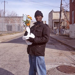 (patrickjoust) Tags: street city flowers portrait people urban usa man color 120 6x6 tlr film analog rolleiflex zeiss america square lens person us reflex md alley focus fuji mechanical united side north patrick twin maryland baltimore east chrome vase medium format states manual middle expired 80 joust fujichrome e6 f28 220 planar estados astia 80mm 100f reversal unidos 28f franke autaut heidecke patrickjoust