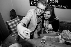 Analog selfie (Gary Kinsman) Tags: london canon5d canon28mmf18 canonspeedlite430exii pub party bar barnsbury flash n1 2010 islington candid unposed bw blackwhite selfie selfportrait analogselfie couple people person