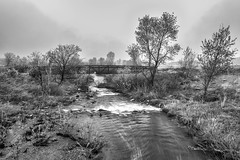 A misty day. (UnknownNet Photography) Tags: longexposure bridge blackandwhite bw mist nature water