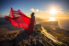 Fair Faroes (West Leigh) Tags: ocean travel sunset red sky woman mountains nature wind dream wanderlust explore experience summit faroeislands reddress wander discover antlantic travelphotography torshavn slaettaratindur