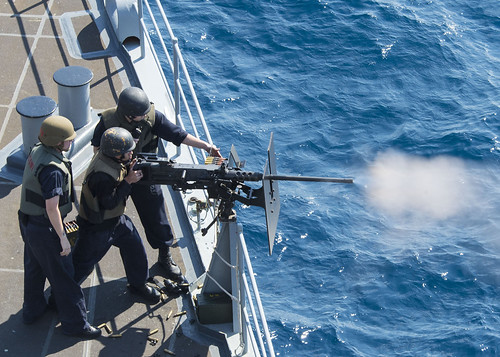 USS Whidbey Island conducts a live-fire exercise.