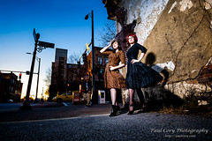 Ladies, with Bystander (Paul Cory) Tags: lighting camera city winter sunset sky people urban woman building tree crimson fashion female buildings season lens model unitedstates northcarolina bluesky structure greensboro softbox onlocation strobe citystreet geolocation postprocessing fujicamera timeofday modifiers downtowngreensboro niksoftware exif:make=fujifilm camera:make=fujifilm lumiquestsoftboxiii exif:aperture=80 colorefexpro4 zeisstouit12mmf28 dianacameronmcqueen exif:lens=touit2812 fujifilmxt1 exif:isospeed=400 exif:focallength=12mm camera:model=xt1 exif:model=xt1 godoxv850 zeisstouitlens
