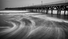 UNTITLED-5 (Dwight Trautmann) Tags: longexposure sea bw costa beach zeiss coast pier muelle mar waves sony playa a7 ndfilter