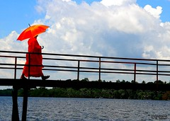 The Walk (3) (Mahmoud R Maheri) Tags: bridge sky orange lake water clouds umbrella walking footbridge monk srilanka