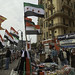 People walk past Syrian and Egyptian flags in Tahrir square in Cairo February 19,