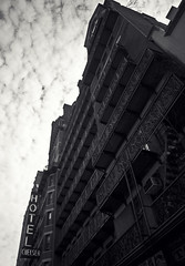 Hotel Chelsea (keroq) Tags: new york city white black color building sign architecture clouds canon vintage photography eos hotel chelsea moody angle manhattan wide overcast 5d 24mm