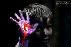 Hand that speaks () Tags: red portrait color colors face kid child hand purple expression fingers dhaka holi bangladesh