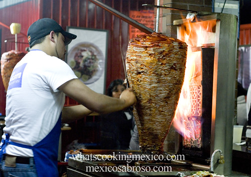 "Trompo<br /><span style=""font-size:0.8em;"">Read more about it here: <a href=""http://whatscookingmexico.com/2012/02/13/the-anatomy-of-a-taco/"" rel=""nofollow"">whatscookingmexico.com/2012/02/13/the-anatomy-of-a-taco/</a></span> • <a style=""font-size:0.8em;"" href=""https://www.flickr.com/photos/7515640@N06/6862930841/"" target=""_blank"">View on Flickr</a>"