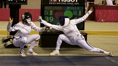 Look around and I kick you ! (MFEYE) Tags: world senior sport french championship team italian aperture action touch grand du prix surprise fencing february dame monde coupe gcc 2012 doha qatar facebook aspire fevrier escrime pe mouvements d90 fente ladiy nisima moellhaus
