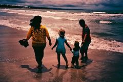 Happy Family (freebird) Tags: bali film beach indonesia seaside lomo lomography fuji cross processed kuta