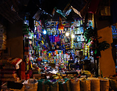 A Boy's Wealth (Kenny Ken) Tags: boy shop bulb night pentax spice morocco spices fez souk merchandise sell selling fes grocers
