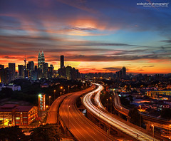 rushing out from the city (acidsulfurik) Tags: longexposure sunset cityscape malaysia twintowers lighttrails kualalumpur metropolitan hdr highdynamicrange klcc bandar dynamicrangeincrease photomatix leadingline tonemapped tonemap leadin jelatek acidsulfurik pprjelatek