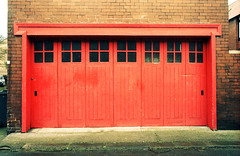Red Doors (Saturated Imagery) Tags: red film rollei 35mm iso200 doors garage retro german praktica otley filmslr vivitar28mmf25 epsonv500 prakticatl5b rolleidigibasecn200 unmaskfilm
