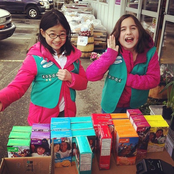 Rae and Cami of troop 43504 selling girl scout cookies outside Family Grocer! Come and get em!