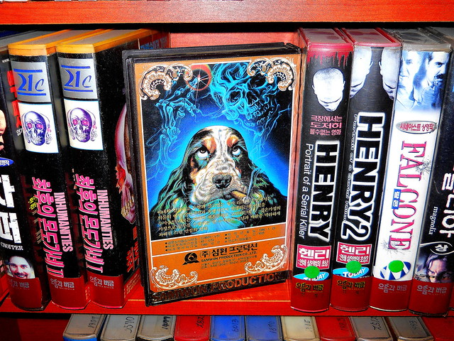 "Seoul Korea unique vintage VHS rental store goofy lurid back cover art for CLINT EASTWOODs ""Tightrope"" on VHS - available for rent in clamshell"