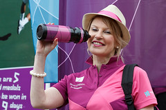 A Team London Ambassador in her pink trimmed trilby hat at the unveiling of Olympic Games uniforms uses her water bottle - London 16 March 2012 (VickieFlores) Tags: pink woman london uniform purple volunteers wimbledon waterbottle ambassadors sw19 2012 olympicgames unveil london2012 teamlondon mayoroflondon wimbledonstation trilbyhat borisjohnson teamlondonambassadors dranadaloisio