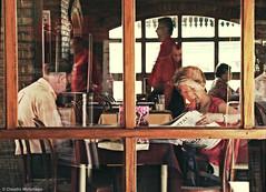 Grouchism / Grouchismo (Claudio.Ar) Tags: street city people woman santafe reflection men window argentina bar self reading candid sony journal ciudad topf100 dsc h9 claudioar claudiomufarrege bestcapturesaoi rememberthatmomentlevel1
