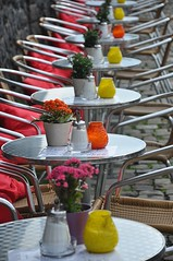 Tables along the river.... (sfPhotocraft) Tags: tables chairs line pillows color germany dsseldorf europe 2014