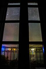 Window to the Stars (Th.Papathanasiou) Tags: sea sky reflection window night canon stars lights nightscape greece tamron evia eviaisland