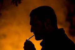 light my fire (Ommation (Vasilis Benakis)) Tags: portrait orange man yellow fire smoke smoking marlboro lighter rolling ciggarette