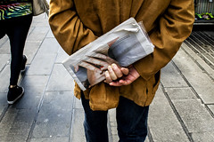untitled (michele liberti) Tags: italy newspaper hands streetphotography napoli naples streetcolors