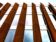 Metal Trumps Glass (Steve Taylor (Photography)) Tags: city blue newzealand christchurch cloud brown white reflection building art window glass metal architecture contrast digital rust iron canterbury nz southisland cbd