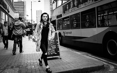 girl about town (streetstory) Tags: uk england bus girl manchester streetphotography morrisons extraterrestrial stagecoach doubledecker docmartens prosecco oldhamstreet fujix100t