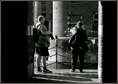 Toggin' down the dock (* RICHARD M (Over 5 million views)) Tags: street friends urban water liverpool docks mono blackwhite chains shadows waterfront candid columns photographers quay unescoworldheritagesite maritime pillars scousers ports flickrfriends albertdock warehouses brickwork urbanrenewal quayside togs merseyside dockland flickrites lightandshade capitalofculture seaports europeancapitalofculture liverpudlians ianhughes togging raywood liverpoollandmarks victorianwarehouses g8lite unescomaritimemercantilecity