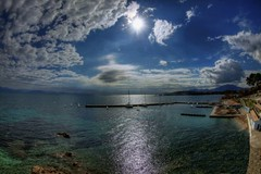corfu (dtsortanidis) Tags: blue sea sky sun colour reflection green water clouds canon boats island day mark sunny fisheye greece ii 5d corfu vacations ionian kerkira   flickraward mygearandme mygearandmepremium mygearandmebronze 815mm