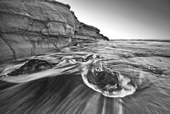 Cardiff Beach B&W3 (Walter B) Tags: ocean california longexposure travel sunset blackandwhite reflection landscape sand nikon rocks waves pacific sandiego tide cardiff cardiffbeach d40x coastalphotography