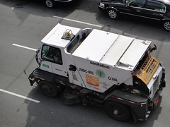 NYC Dept of Sanitation street cleaning truck on Queens Blvd (quiggyt4) Tags: street nyc trash truck garbage boulevard cleaning queens sunnyside ronpaul ows departmentofsanitation occupy occupywallstreet