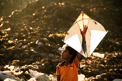 (Arun Titan) Tags: poverty road street travel boy india kite backlight canon photography photo garbage flickr village photos availablelight ambientlight streetphotography naturallight 7d roadside arun eveninglight southindia yellowlight travelphotography ramapuram arunkumar arunr povertyinindia canon18135 canon7d mg6596 boywithkite arun4884 aruntitan ramapuramchennai ramapuramgarbage chennaigarbage