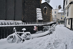 A winter street (RomImage) Tags: street uk roof winter cambridge england orange house snow man cold weather bicycle walking grid nikon alone snowy path step cycle chilly 24 mm nikkor sundaymorning stroll narrow chill greysky footstep cambridgshire pce d700