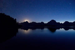 "Teton moonset over Jackson Lake (IronRodArt - Royce Bair (""Star Shooter"")) Tags: park sky moon mountain nature set night dark stars evening twilight shiny long exposure heaven glow shine nightscape time dusk infinity space deep peak grand twinkle astro sparkle galaxy astrophotography astronomy grandtetons universe setting exploration range cosmic lunar starry cosmos astrology moonset constellation distant starlight grandtetonnationalpark starrynightsky"