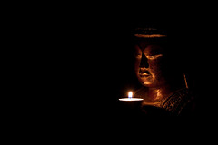 Buddha (Religion, 9/52) (iShoot!) Tags: statue candle buddha religion buddhism lowkey budda swieczka religia canon50d macrobuddhacandlereligionlowkeyreligiabuddaswieczkacanon50d