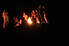 Campfire fun on a Multi sport treking Mountain biking rafting kayaking trip in Nepal